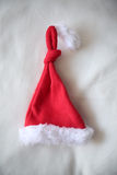 Set of red Santa Claus hats isolated on white background Stock Photo
