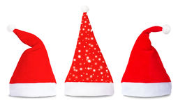Set of red Santa Claus hats isolated. On white background Royalty Free Stock Images