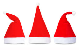 Set of red Santa Claus hats isolated. On white background Royalty Free Stock Photos