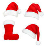 Set of red santa hats and boot. Royalty Free Stock Photos