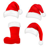 Set of red santa hats and boot. Royalty Free Stock Photo