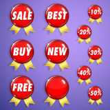 Set of red shiny badges with ribbons on sale Stock Photography