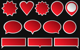 Set of red stickers  on dark background. Various shapes Royalty Free Stock Photography