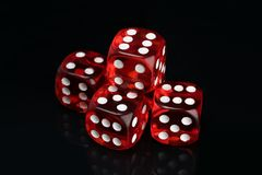 Set of red transparent gaming dice on a black background stock photo