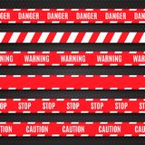 Set of red warning tapes on dark background Royalty Free Stock Image