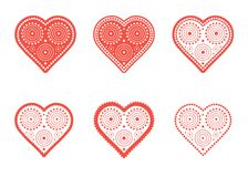 A set of red-and-white images of a heart with a decorative pattern. Royalty Free Stock Images