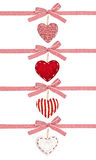 Set of red white ribbon in a strip, with bows and the hearts. On white background Royalty Free Stock Images