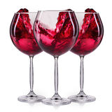 Set of red wineglasses with splash and drops  on white Stock Images