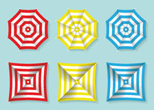 Set of red, yellow and blue beach umbrellas top view. Square and circle sun umbrellas. Vector illustration. Set of red, yellow and blue beach umbrellas top view Royalty Free Stock Image