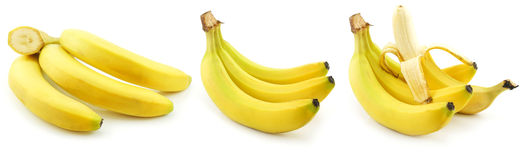 Set reife gelbe Bananen getrennt auf Weiß Stockfotos