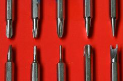 Set of replaceable screwdrivers on red background Royalty Free Stock Images