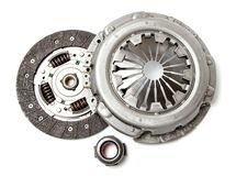 Set of replacement automotive clutch isolated on white background. Disc and clutch basket with release bearing. Set of replacement automotive clutch isolated on stock image