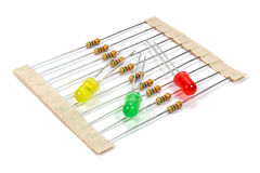 A set of resistors and colored LED diodes on a white background Royalty Free Stock Photo