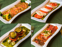 Set of restaurant disges. Eggplant and caprese salads with carpaccio. set of dishes for celebration table Royalty Free Stock Photography