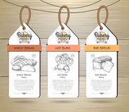 Set of Restaurant labels bakery menu design. On wooden background Stock Photos