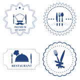 Set of the restaurant labels and kitchen cutlery on white backgr Royalty Free Stock Photos