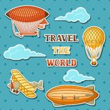 Set of retro air transport. Vintage aerostat airship, blimp and plain in cloudy sky Stock Images