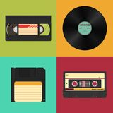 Set of retro audio, video and data storage. Audio, video cassettes, vinyl record and floppy diskette. Set of retro audio, video and data storage on a colored Royalty Free Stock Image