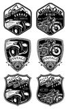 Set of retro badges with car and motorcycle on background with mountains Royalty Free Stock Photos