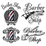 Set of retro barber shop logo. Isolated on the white background Royalty Free Stock Photo