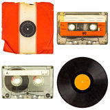 Set of retro compact cassettes and vinyl albums isolated on whit. Set of retro compact cassettes and vinyl record albums isolated on a white background Royalty Free Stock Images