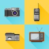Set of retro flat icon. Photo camera, mobile phone, dictaphone, tv set. Set of retro flat icon with long shadow Royalty Free Stock Images
