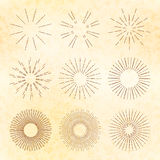 Set of retro hand-drawn starburst and sunrays. Vintage vector elements. Royalty Free Stock Image