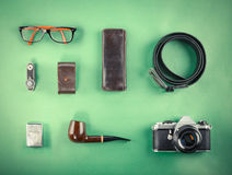 Set of Retro hipster mock up. Laptop, old camera, tablet and smoke pipe on green background. Filtered image. Set of Retro hipster mock up. Laptop, old camera royalty free stock image