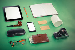 Set of Retro hipster mock up. Laptop, old camera, tablet and smoke pipe on green background. Filtered image. Set of Retro hipster mock up. Laptop, old camera stock photo