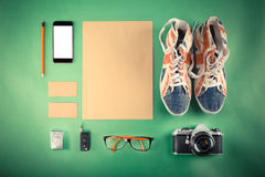 Set of Retro hipster mock up. Laptop, old camera, tablet and smoke pipe on green background. Filtered image. High resolution royalty free stock photos