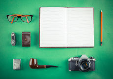 Set of Retro hipster mock up. Laptop, old camera, tablet and smoke pipe on green background. Filtered image. High resolution royalty free stock images