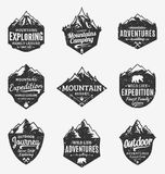 Set of retro styled vector mountain and outdoor adventures logo. Tourism, hiking and camping labels. Mountains and travel icons for tourism organizations Royalty Free Stock Image
