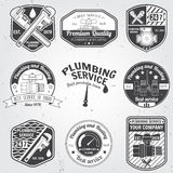 Set of retro vintage badges and labels. Plumbing and heating service.  Stock Image
