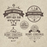 Set of retro vintage Christmas design elements, labels, emblem on old scratched paper. Royalty Free Stock Images