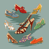 Set of retro vintage female shoes over blue background Royalty Free Stock Photos