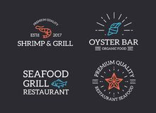 Set of retro vintage fish and seafood, shrimp, starfish, shell logo or insignia, emblems, labels and badges and other. Vector logo or icon design element for Stock Photos