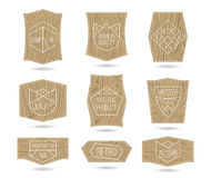 Set of retro vintage quality mark and textured wood board Royalty Free Stock Photos