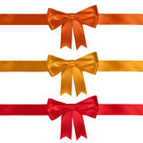 Set of ribbon bows. Red, yellow, orange on white background. Clipping path for each bow included Stock Photography