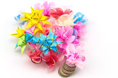 Set ribbon folded into a flower. Wrap coins by hand. I worked fo Stock Photo