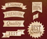 Set of ribbons and labels light brown color. Set of ribbons and labels with text quality and best, premium Royalty Free Stock Photos