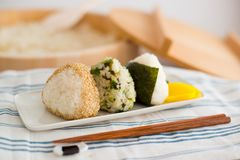 Set of Rice Ball ``Onigiri`` is a typical meal in Japan. Japanese people grab some rice into balls with a shape of triangul in Tokyo, Japan Stock Images