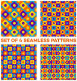 Set of 4 rich seamless patterns with different geometric elements of violet, blue, orange and yellow shades. Set of 4 abstract rich seamless patterns with Royalty Free Stock Images