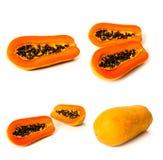 Set of ripe papaya fruit over white Stock Images