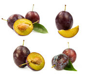 Set of ripe plums with leaves Royalty Free Stock Images