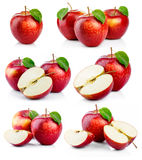 Set of ripe red apples with green leaves isolated Stock Photography