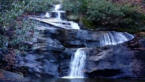 Set Rock Creek Falls in North Carolina. Watch as Set Rock Creek Falls cascades through the Pisgah National Forest in North Carolina stock video footage