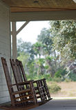 A set of rocking chairs Stock Photos