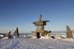 Set of rocks and a inuksuk and inukshuk found in early November near Churchill. Manitoba Stock Image
