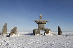Set of rocks and a inuksuk or inukshuk found near Churchill. Set of rocks and a inuksuk or inukshuk found in early November near Churchill, Manitoba Stock Image