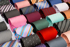 Set of rolled up neck ties. In the market Stock Photos